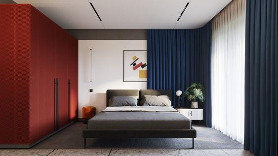 camera da letto con armadio rosso, tende blu e struttura letto verde oliva